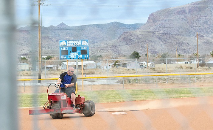 KHS softball coach Craig Lee gets the field ready before getting the Lady Bulldogs ready for their upcoming season.