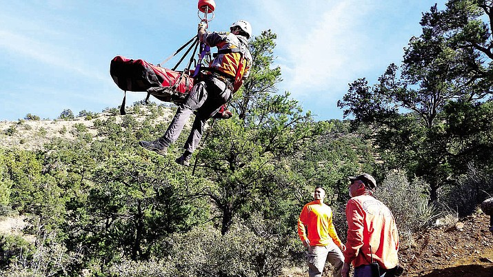 Mike Page, 70, is rescued Tuesday by SAR in the Hualapai Mountains.