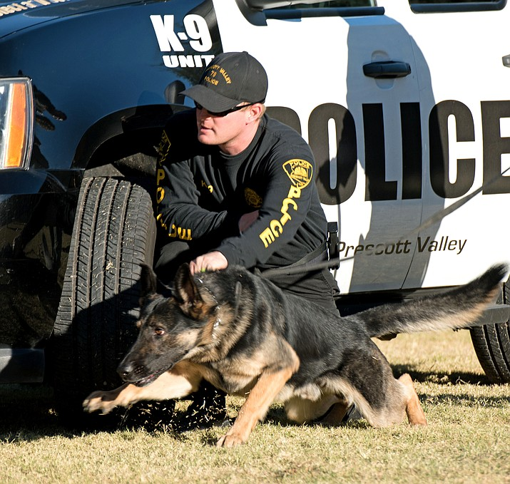 Prescott Valley Police Department Officer Matt Williams with Turco. (Arizona Department of Corrections/Courtesy photo)
