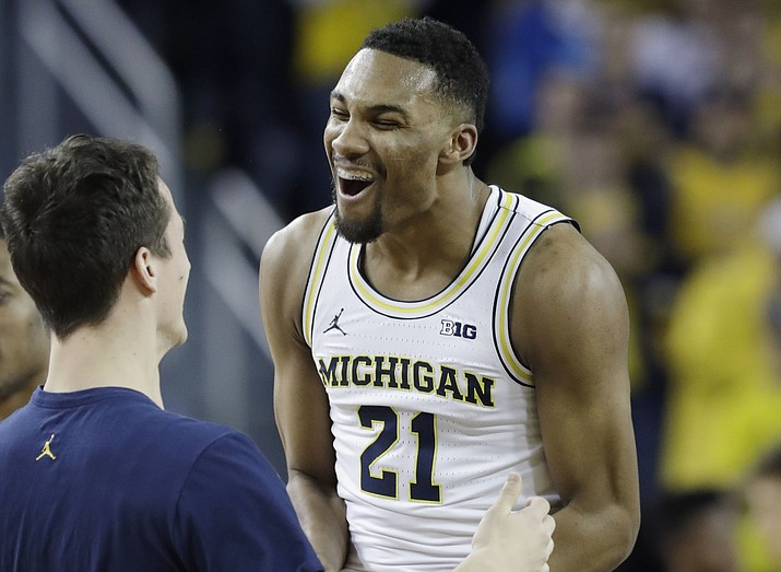 Michigan guard Zak Irvin (21) reacts after a 3-point basket during the first half Thursday, Feb. 17, against Wisconsin in Ann Arbor, Mich. (Carlos Osorio/Associated Press)