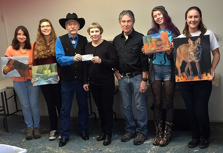 Dennis Gallagher, president of the foundation, presents a $700 check to outgoing President of the Mountain Artist Guild, Janis Keeling. The donation will fund the western art class for the Winter semester. Left to right: Olivia Lugo, Jordyn Bassford, Dennis Gallagher, Janis Keeling, Patrick Harper, a Western Art instructor, Calliandra Bevers, and Hannah Campbell.