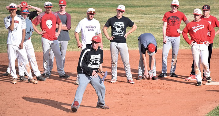 Mingus Union baseball head coach Bob Young shows the Marauders how to run the bases on practice on Tuesday afternoon.Young said he thinks Mingus Union's offense will be better this season. (VVN/James Kelley)