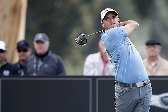 Sam Saunders tees off on the ninth hole during the first round of the Genesis Open golf tournament at Riviera Country Club Thursday, Feb. 16, in the Pacific Palisades area of Los Angeles. (Ryan Kang/Associated Press)