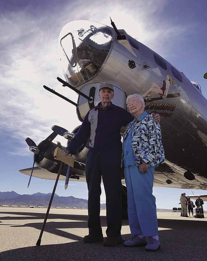 "Elmer Eckstrom and Vivian Stout stand in front of the B-17 ""Aluminum Overcast"" Thursday at the Kingman airport."