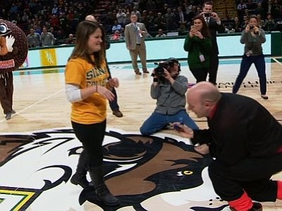 Erin Tobin took part in a Dunkin' Donuts promotion during Thursday night's Manhattan-Siena game at the Times Union Center in Albany. She and the crowd were in for several surprises.