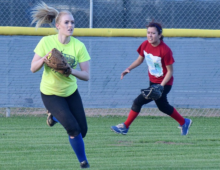 Camp Verde senior Tiauna Day tracks down a ball in the outfield as junior Claudia Escabito runs behind her during practice on Tuesday. Photo by James Kelley