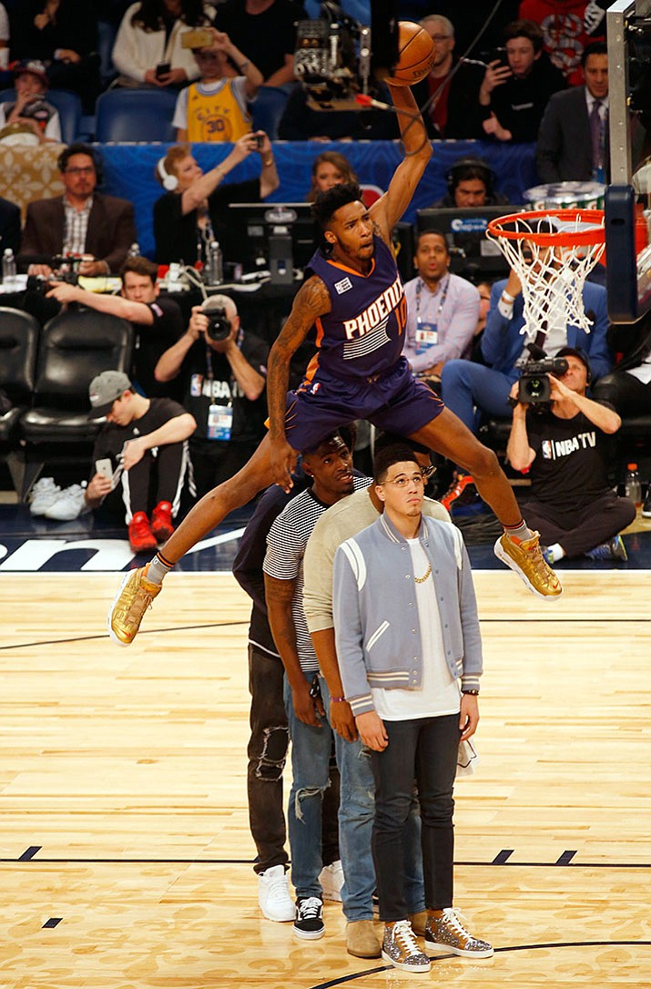 Phoenix Suns forward Derrick Jones Jr. leaps over four people to make a dunk during the slam-dunk contest as part of the NBA All-Star Saturday Night events in New Orleans, Saturday, Feb. 18.