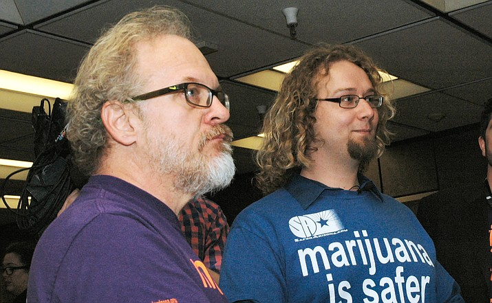 David Wisniewski and Alex Gentry, organizers of a petition drive to legalize marijuana, chat with reporters Thursday after filing the paperwork to start gathering signatures to put the measure on the 2018 ballot. (Capitol Media Services photo by Howard Fischer)