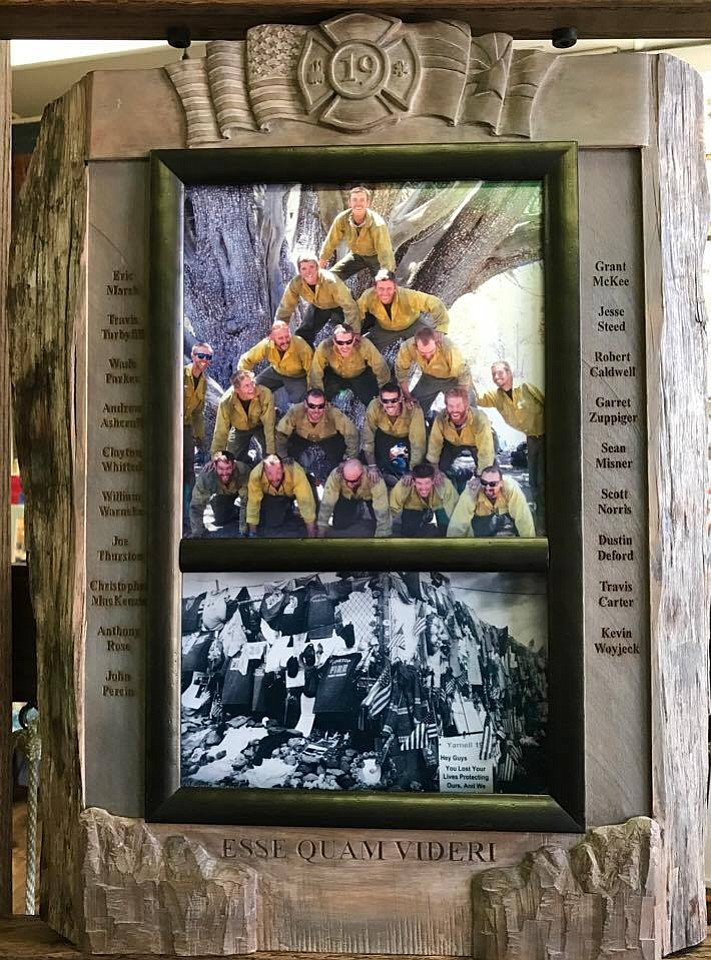 An art piece currently on display at The Frame and I in downtown Prescott features two photos that depict the Granite Mountain Hotshots in a frame of engraved juniper wood.
