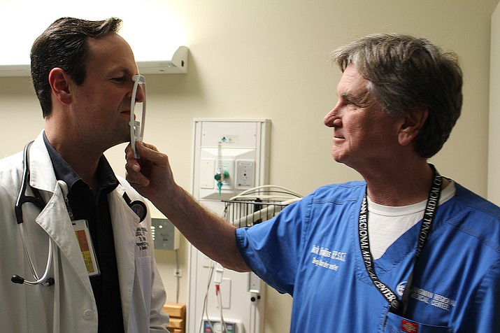 Mark Hopkins, right, measures the nose of Dr. Haven Malish, director of the KRMC Sleep Center. Hopkins uses self-hypnosis to help patients with sleeping disorders. The center recently expanded to six beds at KRMC's Hualapai Mountain Campus.