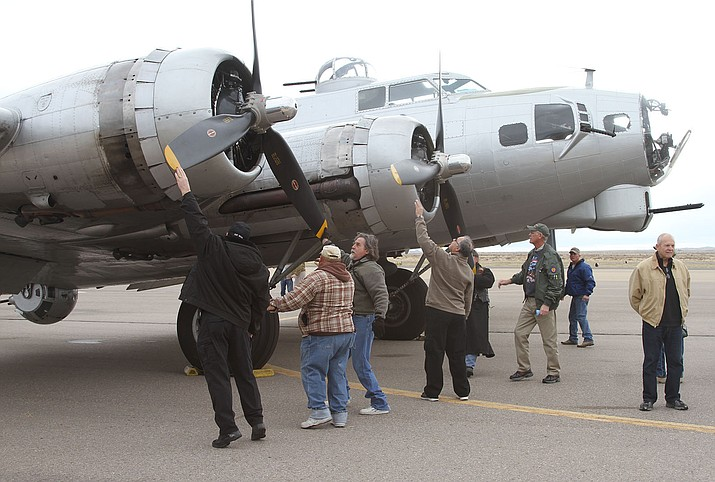 Tour participants help start spinning the propellers Friday morning.