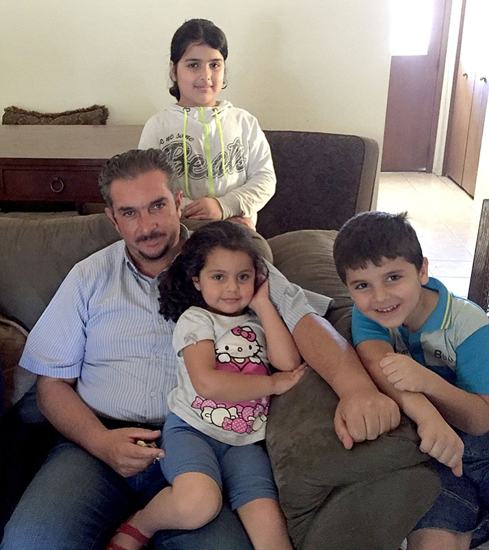 Akram Zreikat, shown here with three of his four children in June 2016, has settled with his wife and mother in the Phoenix area after escaping from Syria and living in a refugee camp. He will speak Feb. 25 about his experience.