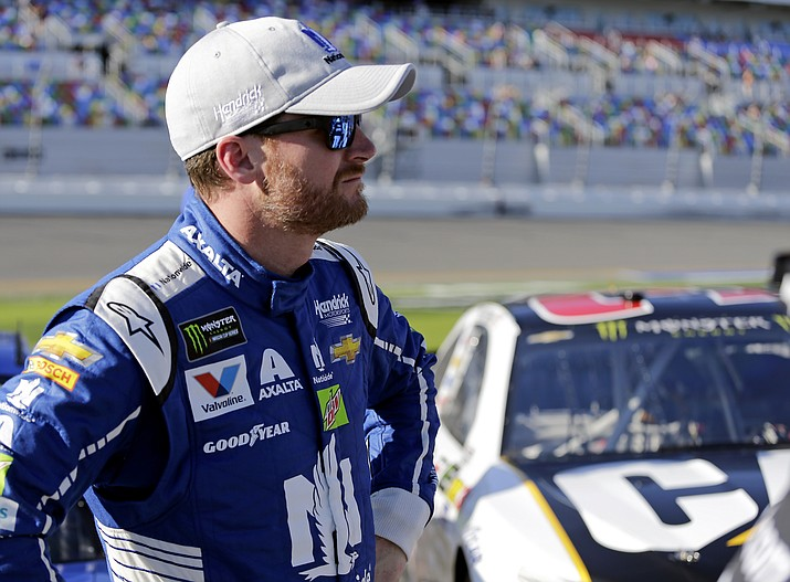 Dale Earnhardt Jr. stands on pit road after his qualifying run for the NASCAR Daytona 500 auto race at Daytona International Speedway on Feb. 19 in Daytona Beach, Fla. Earnhardt Jr. will start the race in the No. 2 position. (Terry Renna/Associated Press)