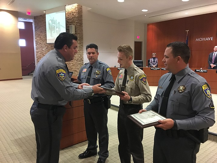 "Mohave County Sheriff Doug Schuster presented Life Saving awards to MCSO Deputies, from left, Ed Trafecanty, Vincent Beltran and Kyler Cox for their actions in saving an 18-month-old girl after a Sept. 24, 2016, boating accident at Lake Mead. It was ""utter chaos"" when the deputies arrived on the scene to learn the girl was trapped under the capsized boat, Schuster said. They had to lift the boat, find the girl and administer CPR before she was airlifted to a hospital in Las Vegas. The girl has fully recovered from the accident."