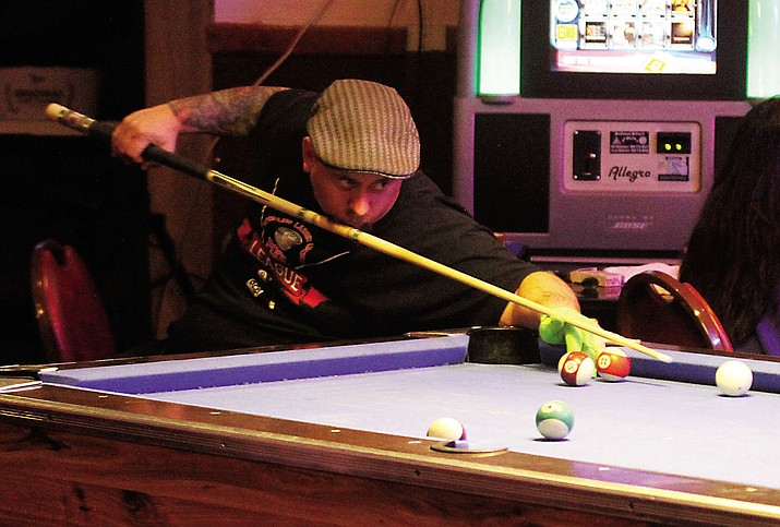 Shane Powell playing pool at Tack Shed Saloon and Eatery on Thursday.