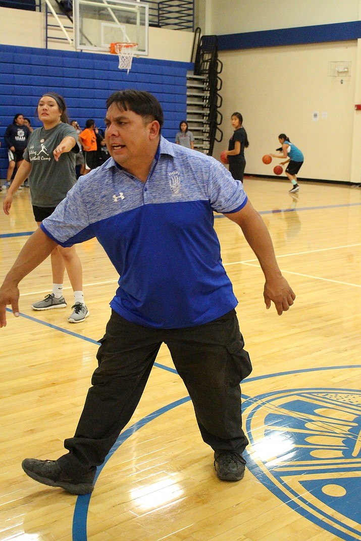 Hopi High Girls Basketball Coach Barry Honyouti yells encouragement to his team. It paid off as the Lady Bruins made it to state. Photo/Stan Bindell