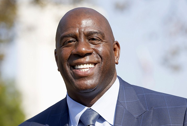 Former Los Angeles Lakers star Magic Johnson speaks at a groundbreaking ceremony Aug. 23, 2016. Johnson was named director of basketball operations for the Los Angeles Lakers on Tuesday, Feb. 22. (Nick Ut/Associated Press)