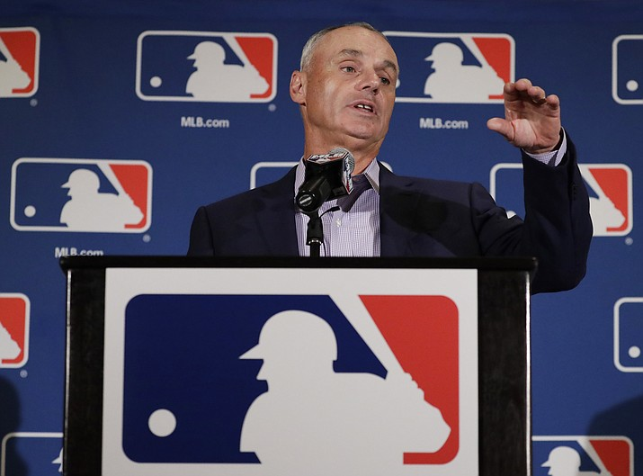 Major League Baseball Commissioner Rob Manfred answers questions at a news conference Tuesday, Feb. 21, in Phoenix. (Morry Gash/Associated Press)