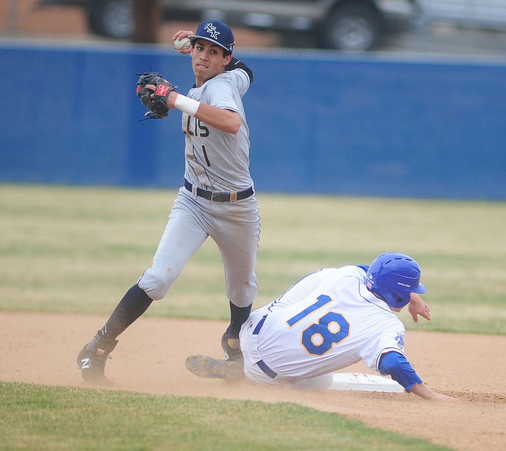 Prescott's Chase Kasun breaks up a double play attempt by Jonathan Ornelas as the Badgers opened the 2017 baseball season against the Raymond Kellis Cougars Wednesday, February 22 in Prescott. (Les Stukenberg/The Daily Courier)