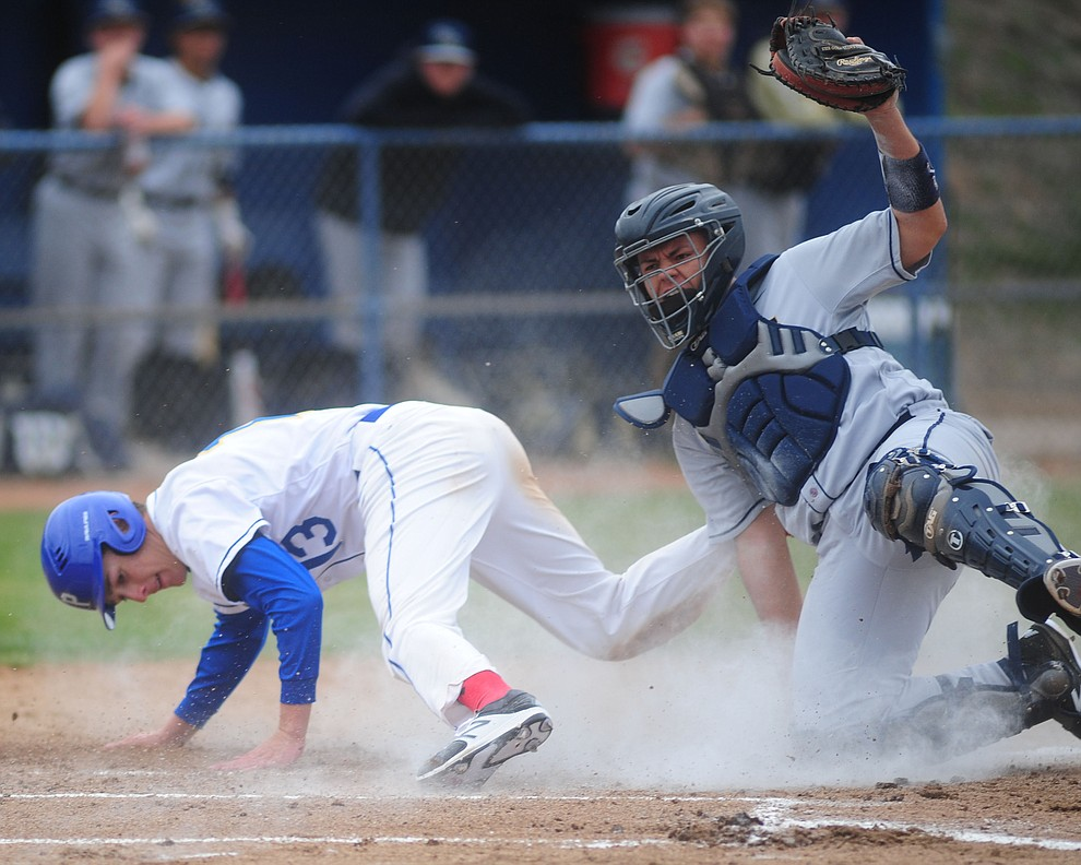 Prescott's Ryan Greene gets tagged out at home as the Badgers opened the 2017 baseball season against the Raymond Kellis Cougars Wednesday, February 22 in Prescott. (Les Stukenberg/The Daily Courier)