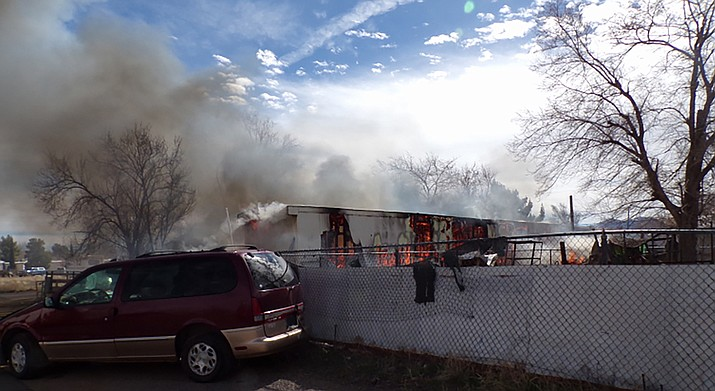 A fire of unknown origin destroyed this home in northern Kingman on Tuesday.