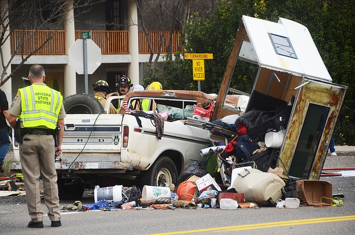 Emergency crews respond to a head-on collision that involved a motorhome and pickup truck Wednesday afternoon at SR 89A and Oasis Drive in Cottonwood. (VVN/Vyto Starinskas)