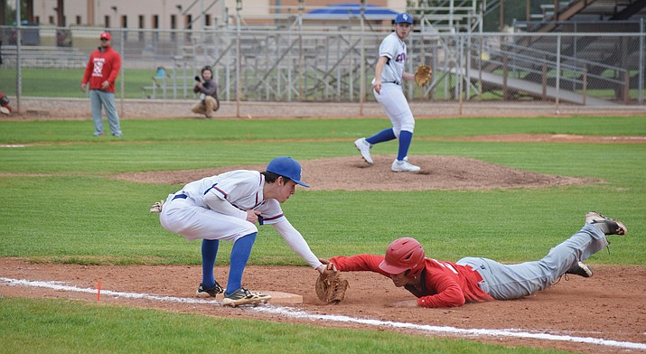 Camp Verde senior John Castillo tags out a Mayer runner after senior Easton Braden succesfully picked the Wildcat off. The Cowboys scored four runs in the third and 10 in the fourth inning to rout Mayer in the first game of the season. (VVN/James Kelley)