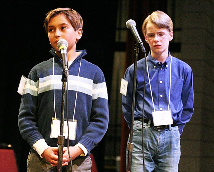 For the third consecutive year, Prescott Valley's Tanner Dodt, right, won the Yavapai County Spelling Bee. Tanner is shown competing against Sedona Charter School's Lazor Lanson in a finals that lasted 24 rounds. The three-hour competition lasted a total of 42 rounds before Tanner correctly spelled the word euthanasia.