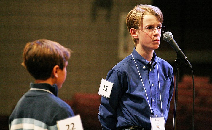 For the third consecutive year, Prescott Valley's Tanner Dodt, right, won the Yavapai County Spelling Bee. Tanner is shown competing against Sedona Charter School's Lazor Lanson in a finals that lasted 24 rounds. The three-hour competition lasted a total of 42 rounds before Tanner correctly spelled the word euthanasia. (Photo by Bill Helm)