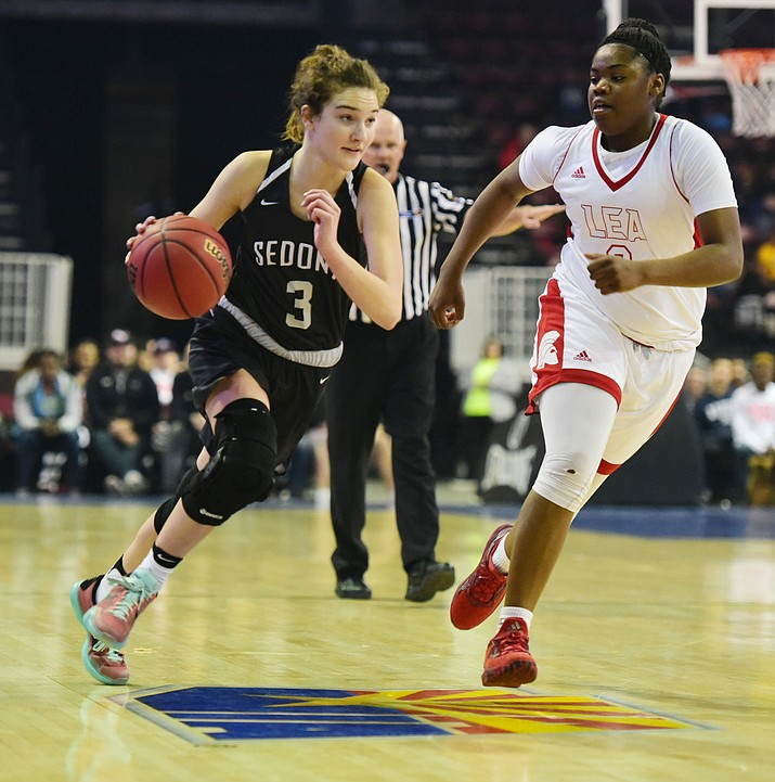Sedona's Mary Westervelt drives the ball upcourt as the Lady Scorpions take on the Leading Edge Academy Lady Spartans in the AIA 2A State Semifinals Friday, February 24 at the Prescott Valley Event Center. (courtesy Les Stukenberg/The Daily Courier)