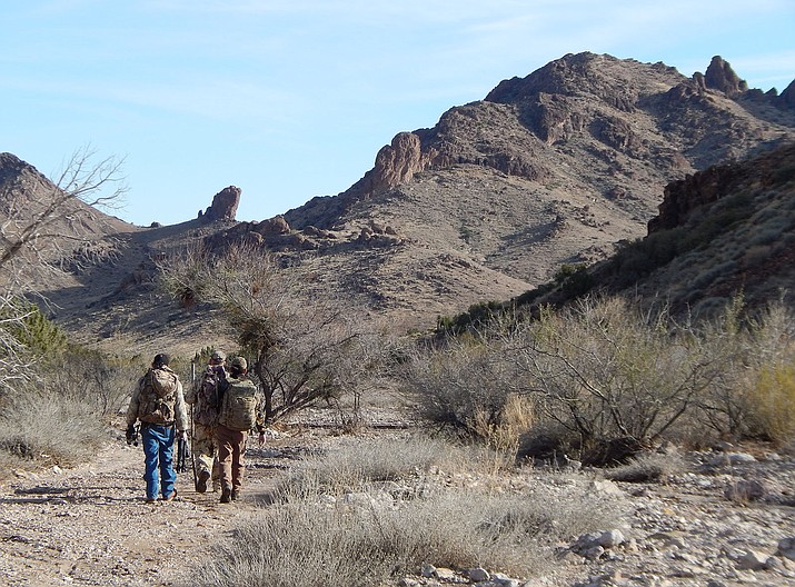 A hunter, his guide and a helper stalk bighorn sheep in the Bureau of Land Management-managed Black Mountains. The possible repeal of a new BLM rule could pose problems for outdoor enthusiasts, says conservationist.
