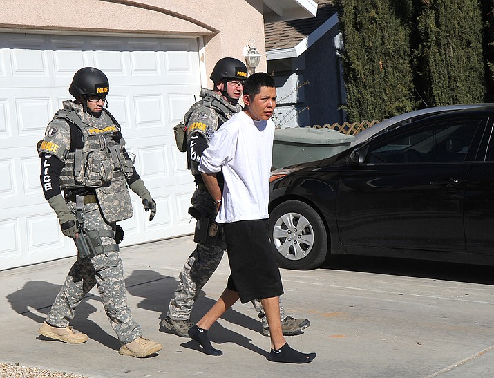 Kingman Police take Kevee C. Williams into custody after an early morning stand-off.