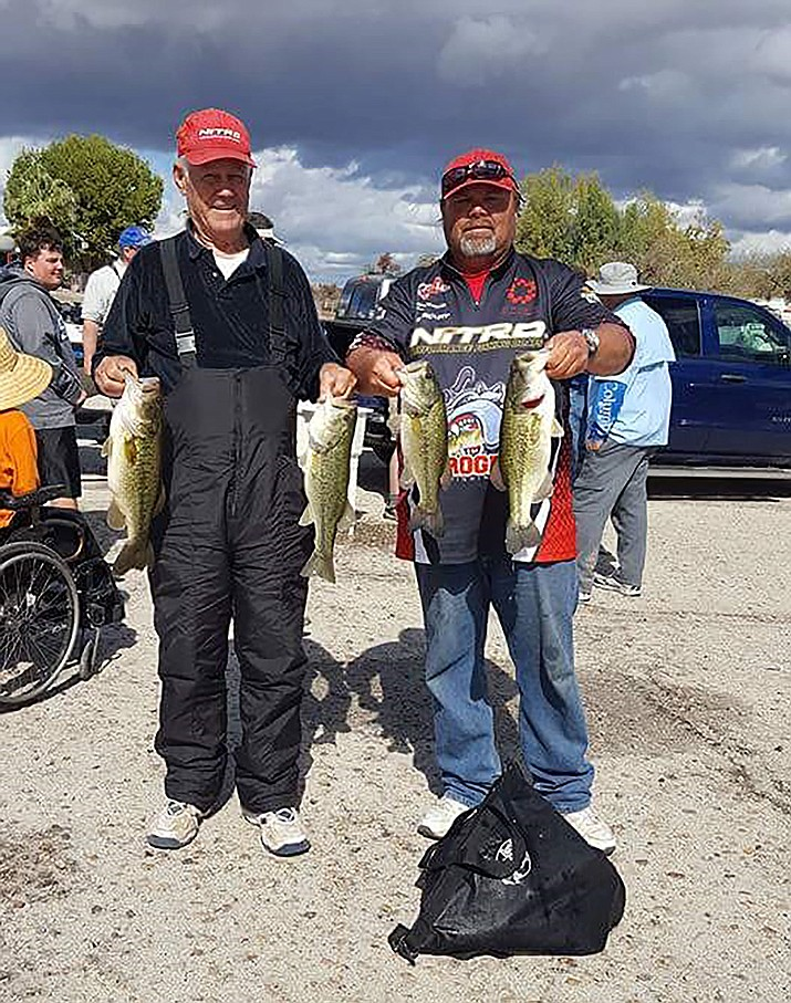 Ray and Donnie Scroggins didn't let a lot of rain dampen their fishing tournament.