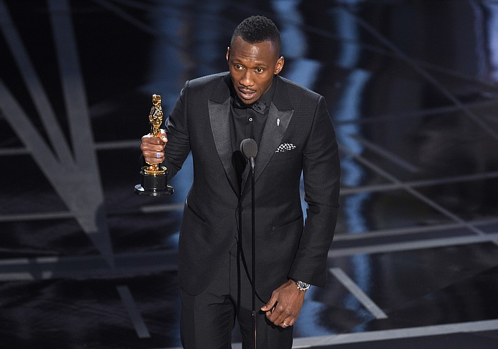 "Mahershala Ali accepts the award for best actor in a supporting role for ""Moonlight"" at the Oscars on Sunday, Feb. 26, at the Dolby Theatre in Los Angeles. (Chris Pizzello/Invision/AP)"