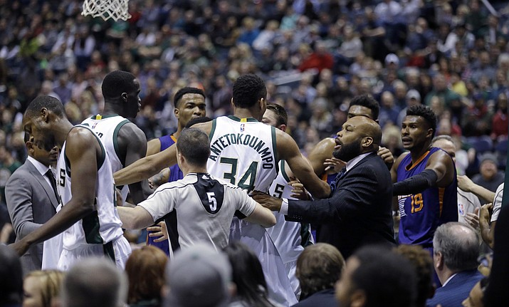 Players from the Milwaukee Bucks and Phoenix Suns have to be separated after a shoving match during the first half of an NBA basketball game Sunday, Feb. 26, 2017, in Milwaukee.