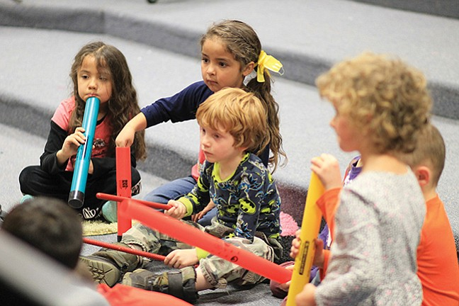 Kindergartners at Williams Elementary-Middle School use Boomwhackers to learn about rhythm and sound. The instruments were donated to the school by Williams Alliance for the Arts.