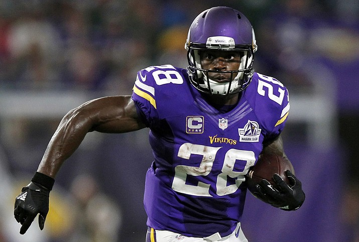 In this Sept. 18, 2016, file photo, Minnesota Vikings running back Adrian Peterson carries the ball during the first half of an NFL football game against the Green Bay Packers, in Minneapolis. Peterson is returning to practice this week for the Vikings for the first time since tearing the meniscus in his right knee in September. Coach Mike Zimmer says he expects Peterson to practice all week. He is not sure if his star running back will be available to play the Indianapolis Colts this weekend. (Andy Clayton-King/Associated Press)