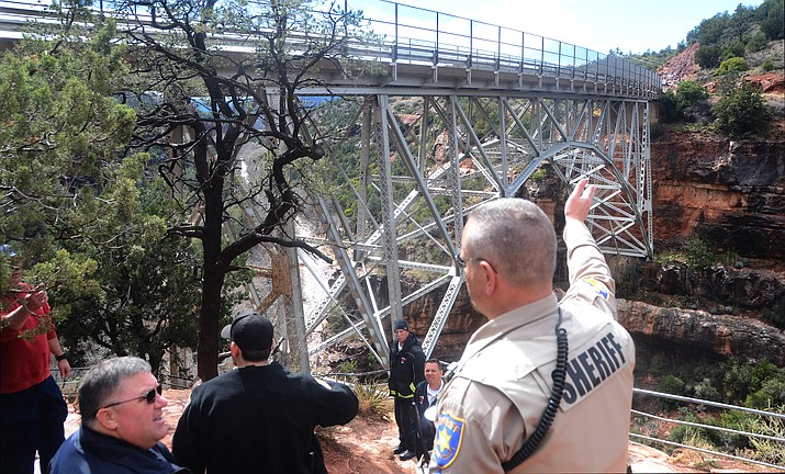 The person whose body was recovered Tuesday afternoon from the creek below Midgley Bridge has been identified as a 20-year-old male who was a student at Arizona State University. (VVN/Vyto Starinskas)
