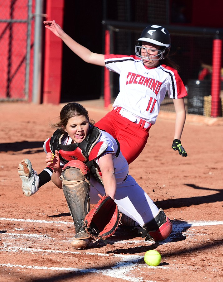 Bradshaw Mountain catcher Katie Grandy tries to get the out at home as the Lady Bears take on Coconino in Prescott Valley Thursday, March 2. (Les Stukenberg/The Daily Courier)