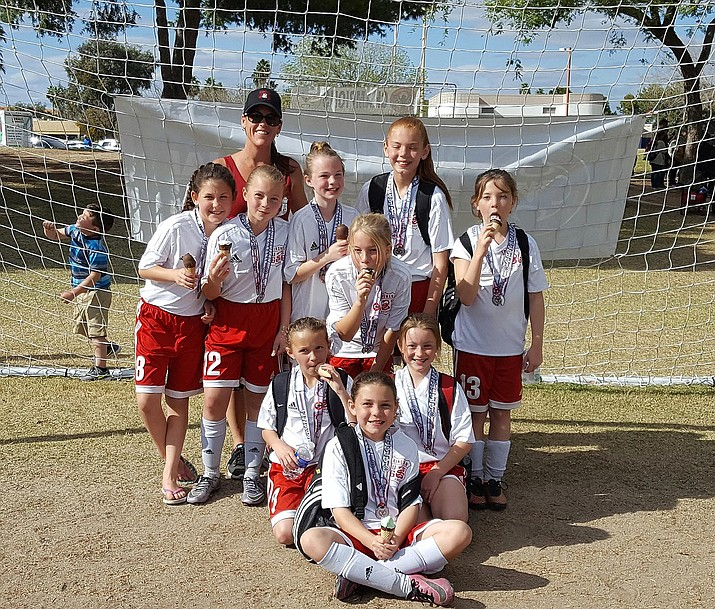 Kingman Soccer Club's G06 in the back row right to left Berlynn Bratley, Sophia Fottrell, Abby Harviston, Isabel Wilcox, Cielo Lobato, Courtney Witt.  Bottom left to right Gwen Otero, Lauren Keller and Madison Brisco.