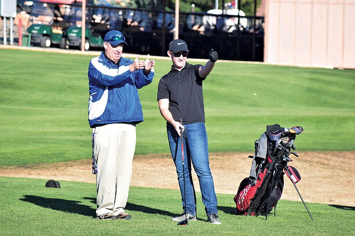 Camp Verde golf head coach Christian Fuller helps junior Nick Daniels before he tees off at practice on Wednesday at Verde Santa Fe Golf Course. Fuller said Daniels has a lot of potential. (VVN/James Kelley)