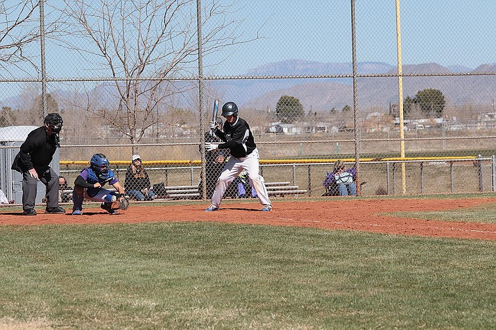 Kingman Academy's Donald Tatham looks at a pitch against Lake Havasu during Kingman's baseball tournament on Thursday.