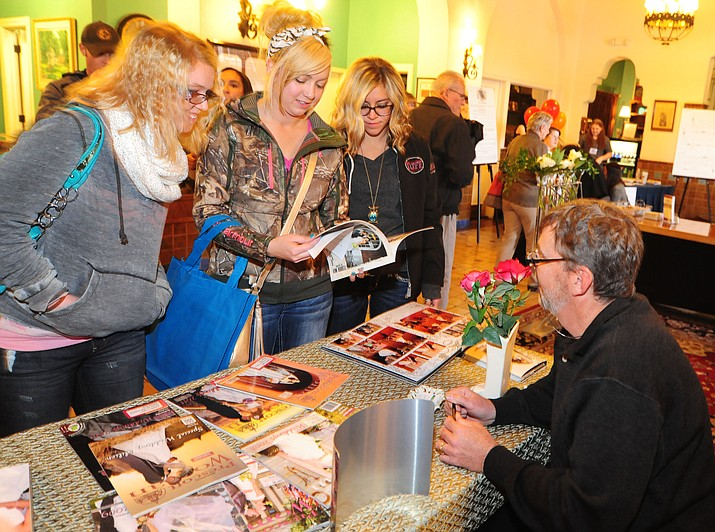 Kaylee Greenleaf, Shelby McCaslin and Andreya Foley looks at some of the photo opportunities offered by Portrait Park by J at the 10th annual Prescott Bridal Affaire Expo at the Hassayampa Inn on Sunday, March 1, 2015. This year's Bridal Affaire will be held Sunday, March 5.