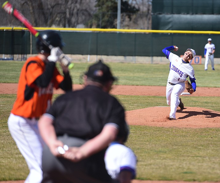 Chino Valley's Skylar Brooks delivers a pitch as the Cougars face off against Williams at their home opener in Chino Valley Friday, March 3.  (Les Stukenberg/The Daily Courier)