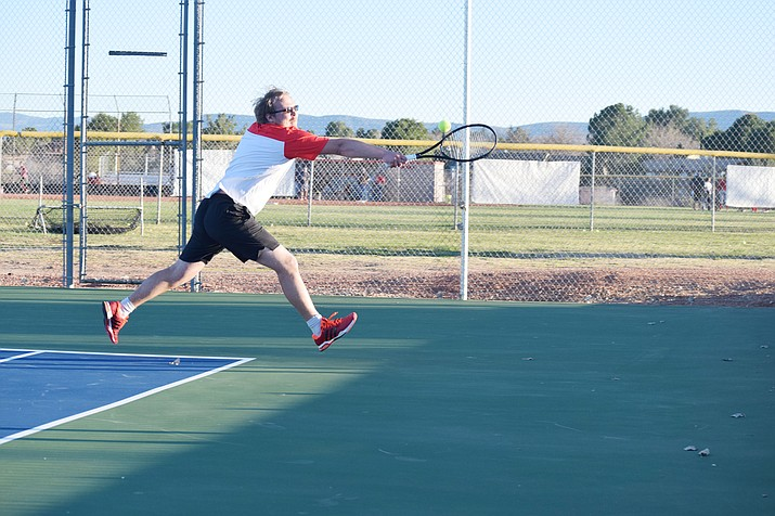 Mingus Union senior Alex Flannery reaches to return the ball during the Marauders' 9-0 loss to Agua Fria during a doubles match. Flannery and junior Nick Ruggiero lost the doubles match 9-7, in the first time they've played together. (VVN/James Kelley)