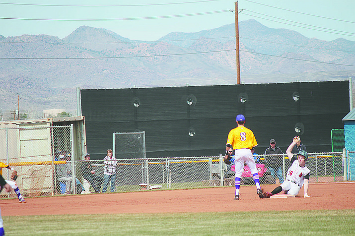 Lee Williams' Chad Moore slides safely into second base as Lake Havasu's Gavin Dorhn during the Volunteers' 8-1 win to capture the Big Red Construction Kingman High School Baseball Invitational Tournament championship Saturday at KHS.