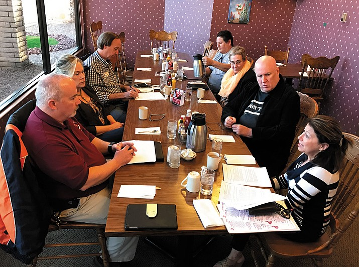 City Manager John Dougherty, front left, and Mayor Monica Gates, front right, meet with with constituents for coffee Friday at Calico's. The Mayor's Morning Mingle set to table, so to speak, for the regular Kingman City Council Meeting at 5:30 p.m. Tuesday at City Hall