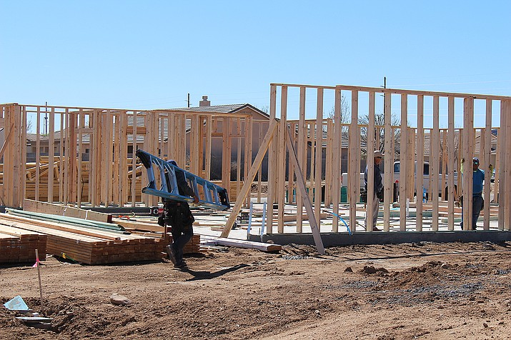 Construction workers put up the framing for a new home in the Walleck Ranch subdivision being built by Cantrell Development. Cantrell was issued one of nine single-family residence building permits from the city of Kingman recently. The homes were valued from $138,540 to $257,930.