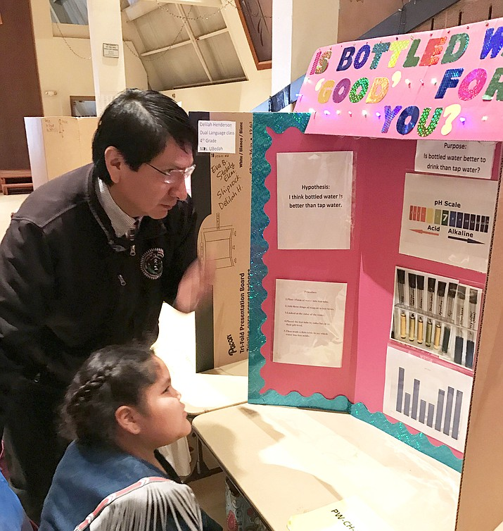 "Vice President Jonathan Nez listens to a student from Eva B. Stokely Elementary School present her project titled, ""Is Bottled Water 'Good' For You?"""