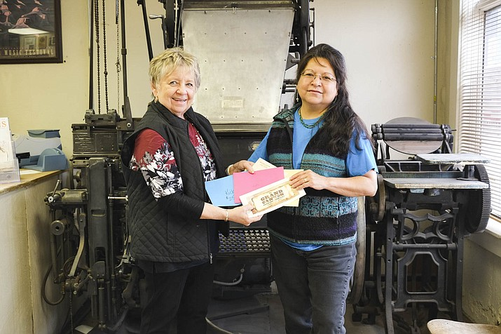 Williams News Advertising Executive Connie Hiemenz presents Patricia Helgeson with gift certificates from Kicks, Jeff's at Goldies Route 66 Cafe, Clover Hill Shell, Wild West Junction and the Grand Canyon Brewery after she won the 2017 Super Bowl contest in the Williams News.